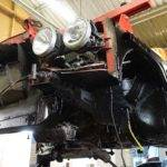 car repair services stripped down red car